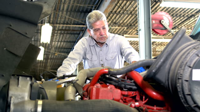 senior hispanic man repairing semi-truck - bonnet stock videos & royalty-free footage