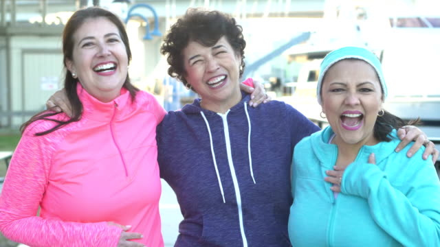 senior hispanic woman and friends smiling at camera - 50 59 years stock videos & royalty-free footage