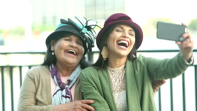 senior hispanic woman, daughter, selfie in stylish hats - candid stock videos & royalty-free footage