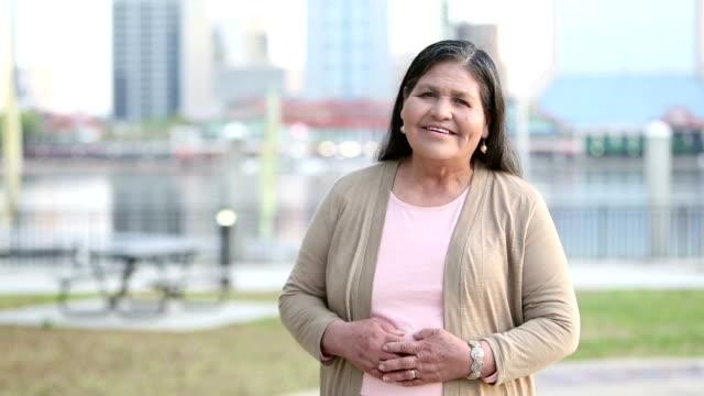 senior hispanic woman near city waterfront - waterfront stock videos & royalty-free footage