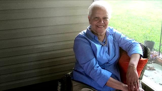 senior hispanic woman relaxing on screened porch - veranda stock videos & royalty-free footage