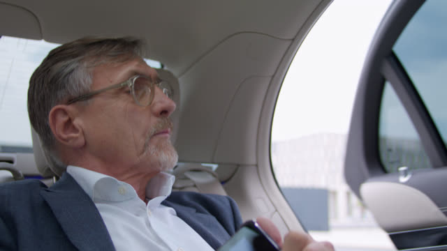 senior hon business man in his 60s gets chauffeured in luxury limousine to the airport, the chauffeur opens the door and the vip is exiting the car - car door stock videos & royalty-free footage