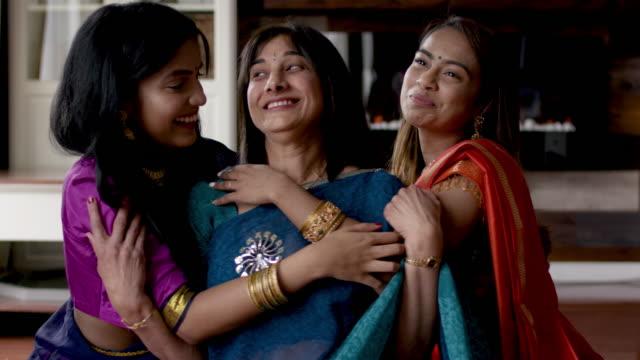 senior indian mother lacht gemeinsam with adult töchter - dashahara stock-videos und b-roll-filmmaterial
