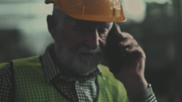 senior industrial talking on phone. - beard stock videos & royalty-free footage