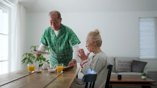 senior japanese couple enjoying the pleasure of breakfast - dining table stock videos & royalty-free footage