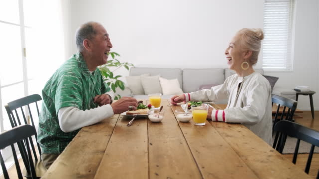 senior japanese wife enjoying breakfast with her husband - dining table stock videos & royalty-free footage