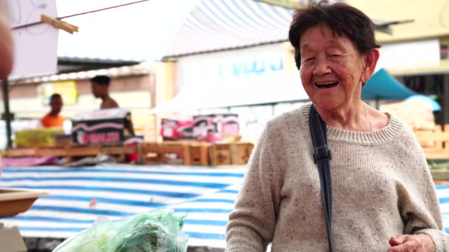 senior japanese woman customer and salesman at farmers market - over 80 stock videos and b-roll footage
