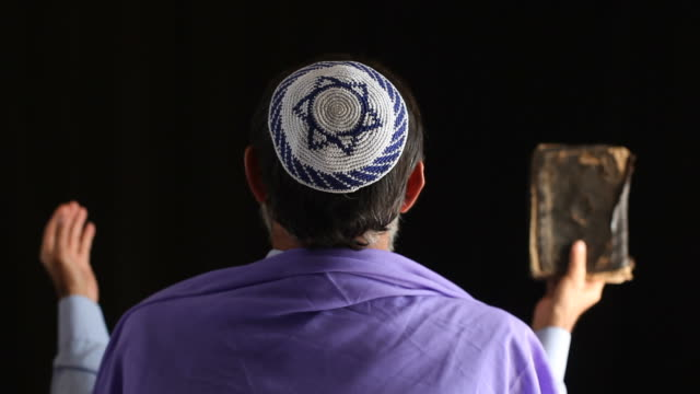 senior jewish man praying ,holy book in hand - judaism stock videos & royalty-free footage