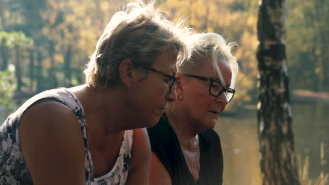 senior ladies talking outdoors - mature women stock videos & royalty-free footage
