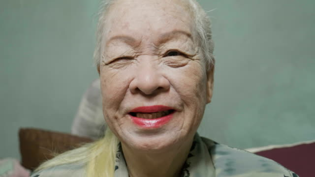 senior lady applying face cream, mascara ,lipstick. make up at home. concept: beauty, life - hygiene stock videos & royalty-free footage