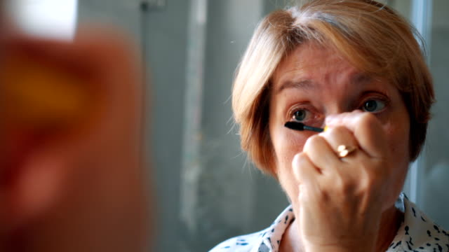 senior lady applying mascara - mascara stock videos & royalty-free footage