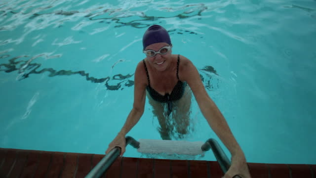 """ms pov senior lady coming out from swimming pool / laguna woods, ca, united states "" - ladder stock videos and b-roll footage"