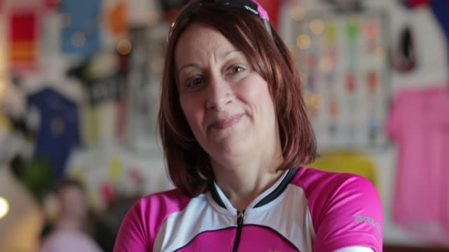 senior lady cyclist portrait - human age stock videos & royalty-free footage