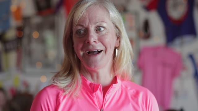 senior lady cyclist portrait - 50 54 years stock videos & royalty-free footage
