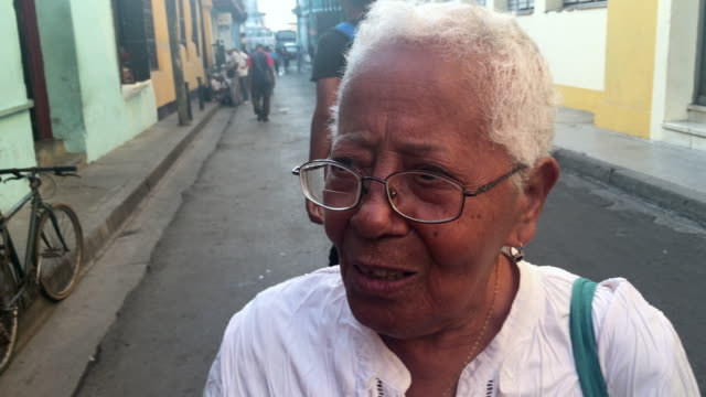 a senior lady sings on the streets of the santiago de cuba city she is joined by juan manuel villy carbonell who is known as 'el benny more of... - afro caribbean ethnicity stock videos and b-roll footage