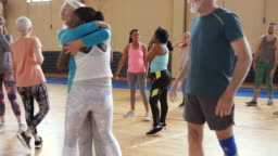 Senior lady supporting younger woman on their Zumba class