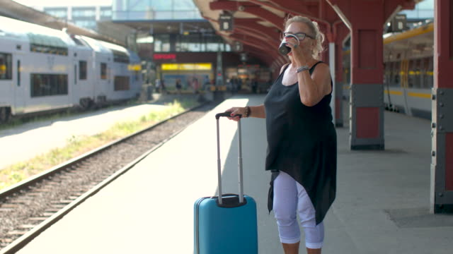 senior lady waiting for a train - sweden stock videos & royalty-free footage