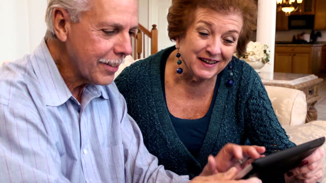 Senior Latin Couple Using Tablet Computer
