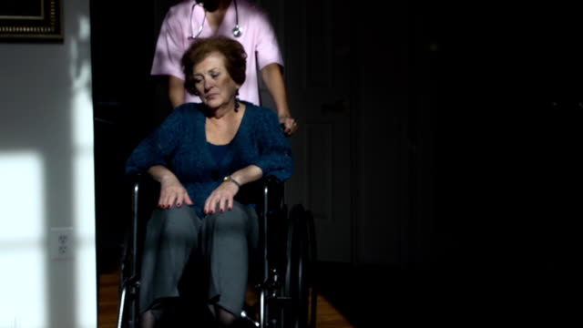 senior latin woman in wheelchair - house call stock videos and b-roll footage