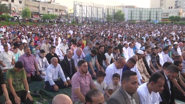 senior leader of hamas ismail haniyeh gives a speech during an islamic mass prayer ritual khutbah during eid alfitr mass prayer on the eid alfitr... - eid ul fitr stock videos & royalty-free footage