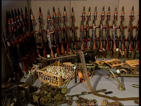 senior libyan diplomat abdul ati al-obeidi meets with british diplomat about ira arms shipments; eire : int room containing arms seizures from ira by... - al reynolds bildbanksvideor och videomaterial från bakom kulisserna