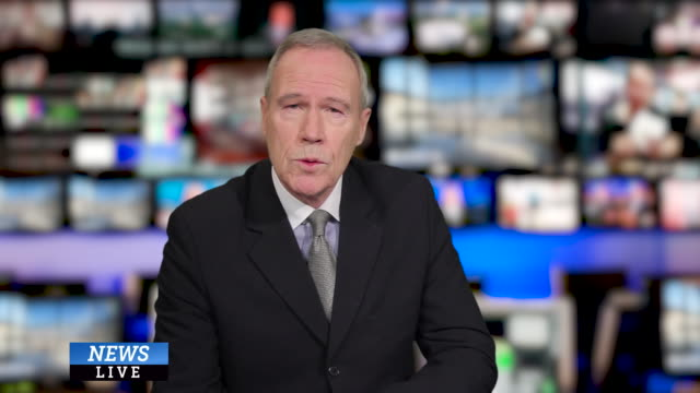 ms senior male anchor speaking at news desk in television studio - presenter stock videos & royalty-free footage