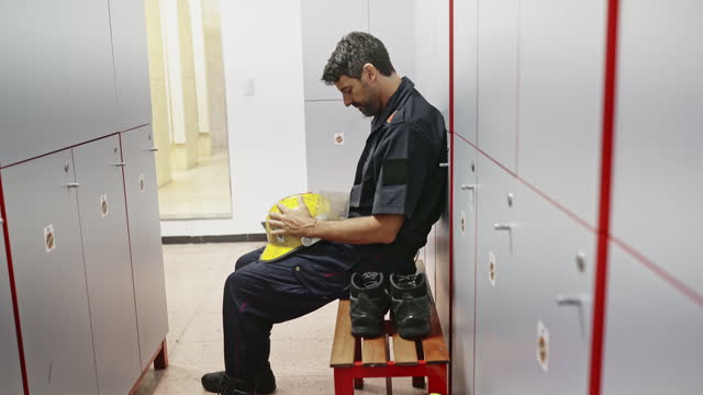 senior male firefighter consoling depressed teammate - emotional support stock videos & royalty-free footage