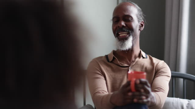 vídeos de stock, filmes e b-roll de senior male having coffee with a friend - male friendship