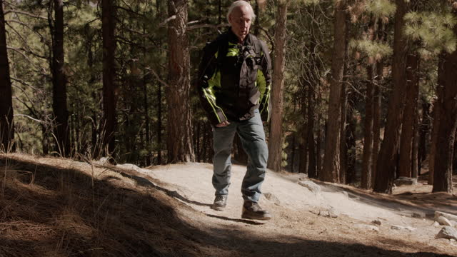 senior male hiking up a hill - nevada stock videos & royalty-free footage