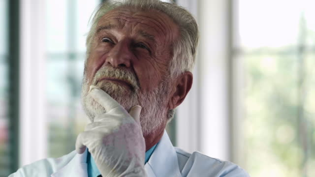 senior male scientific researcher - efficiency stock videos & royalty-free footage