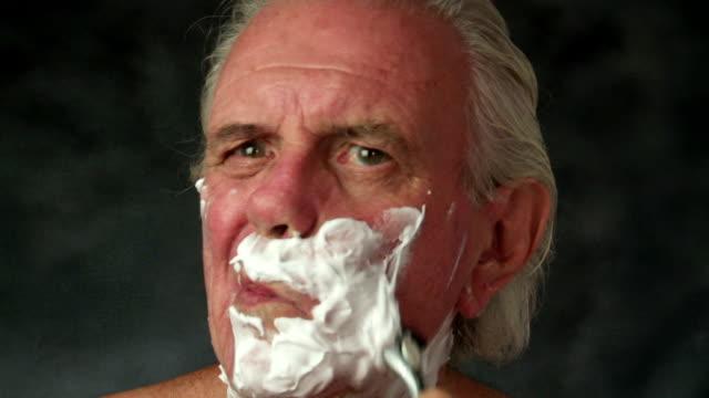 senior male shaving