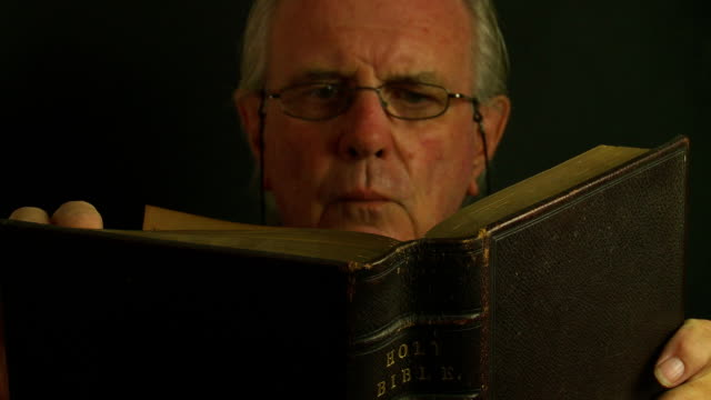 Senior male with bible.