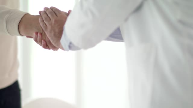 senior man and his doctor shaking hands - midsection stock videos & royalty-free footage