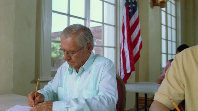 MS Senior man and others taking exam / Tampa, Florida, USA