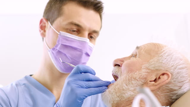 senior man at dentist office - dentist's office stock videos and b-roll footage
