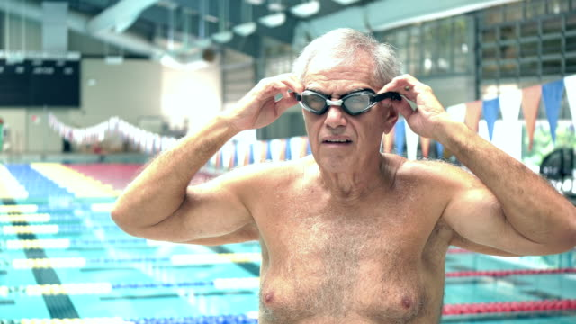 senior man at indoor swimming pool, putting on goggles - chest stock videos & royalty-free footage