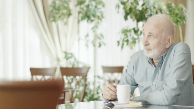 Senior Man At restaurant