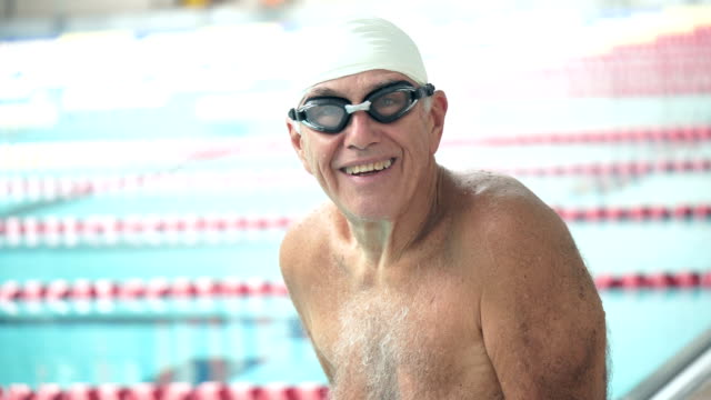 senior man at swimming pool ready to swim laps - swimming cap stock videos & royalty-free footage