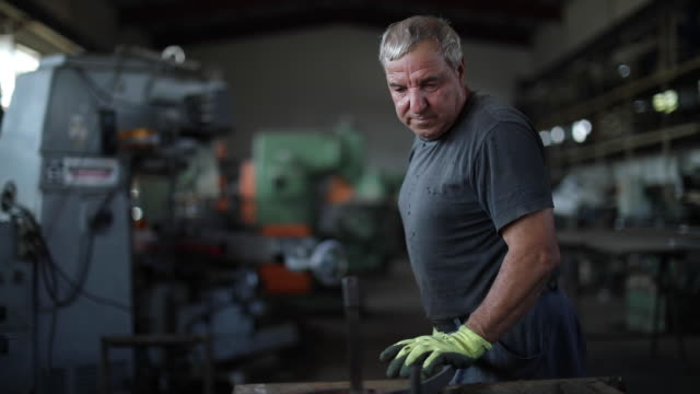 senior man bending forged metal fence - mechanic stock videos & royalty-free footage
