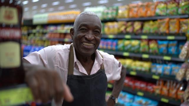 senior man business owner / employee retail - retail manager stock videos & royalty-free footage