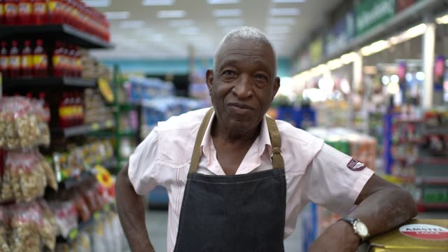 senior man business owner / employee retail - ethnicity stock videos & royalty-free footage