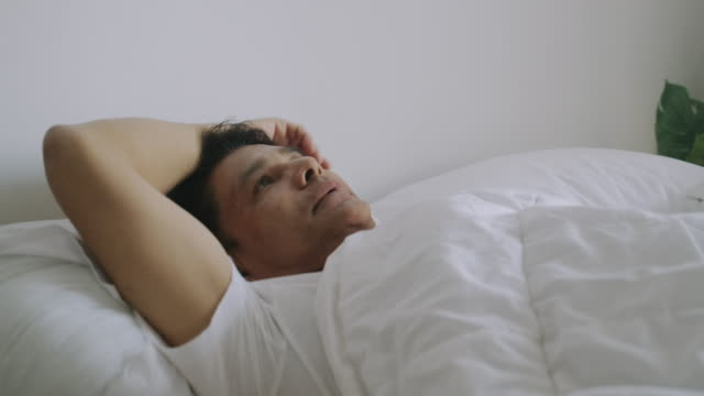 senior man cannot sleep. - sad old asian man stock videos & royalty-free footage