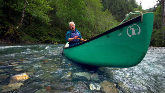 Senior man canoeing on river, Oregon