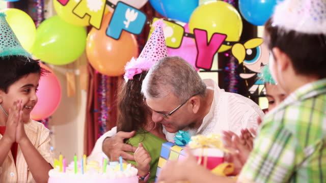 senior man celebrating birthday with his grandchildren  - receiving stock videos & royalty-free footage