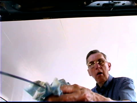 senior man changing engine oil - one senior man only stock videos & royalty-free footage