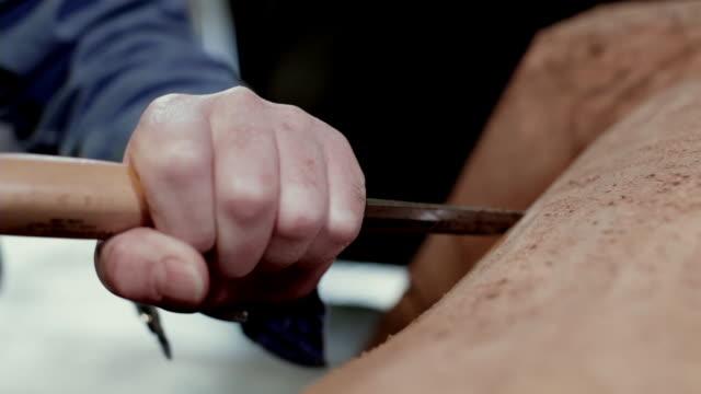 cu senior man chiseling wood in workshop / kingston, new york, usa  - sculpture stock videos & royalty-free footage