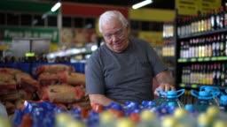 Senior man choosing some products at supermarket
