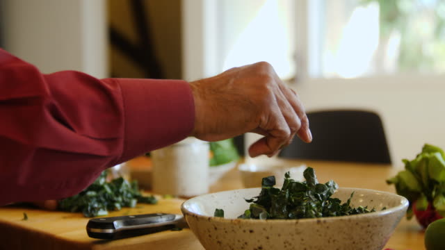 senior man chopping chard at home - leaf vegetable stock videos & royalty-free footage