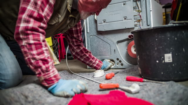 DIY - Senior man cleaning a dryer
