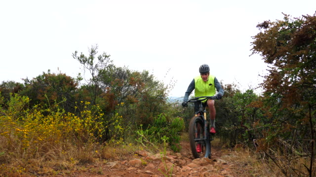 ms senior man climbing hill while riding mountain bike on trail - bicycle trail outdoor sports stock videos & royalty-free footage